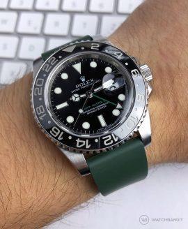 Rolex GMT Master II on green classic Rubber watch strap wrist shot